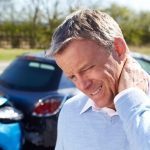 Man with post concussion syndrome caused by whiplash in car accident